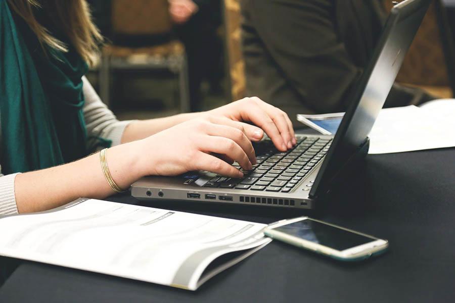 Freelance writer at laptop.