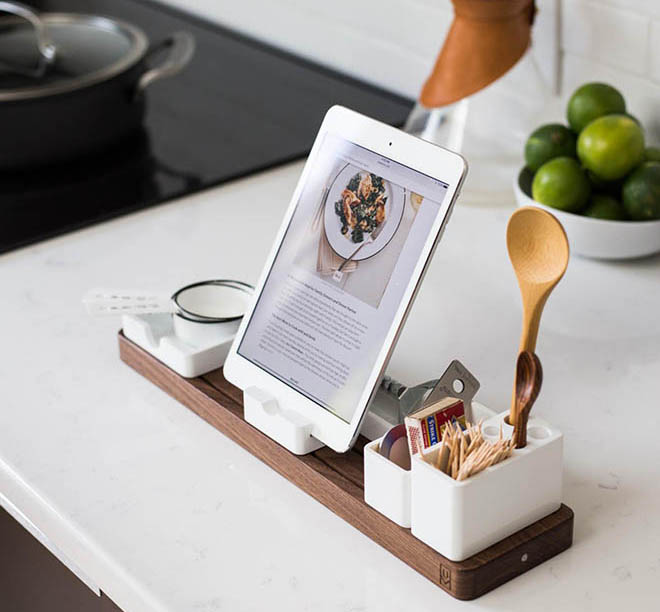 Millennials use mobile devices in the kitchen.